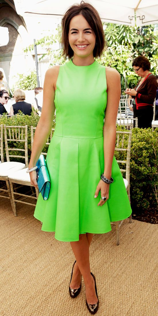 CAMILLA BELLE Belle stole the spotlight in a neon green Ralph Lauren cocktail dress, elevating it even further with a blue iridescent Rebecc...