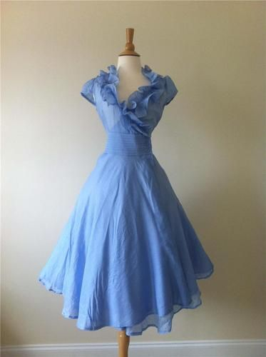 Vintage style periwinkle sun dress.  Love the way the skirt looks like it would just float along.