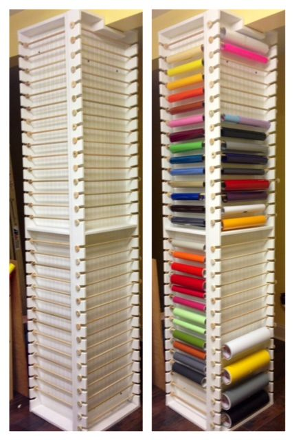 "Rolled vinyl storage for the craft room. 1"" x 4"" frame backed with bead board, 7/16"" dowel rods for hangers.  Holds 60 rolls of vinyl."