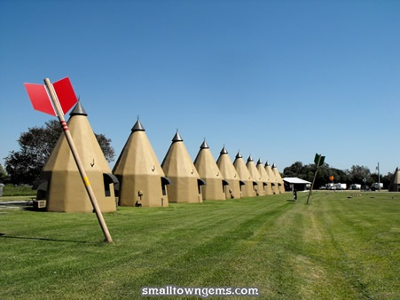 Best Small Town of Wharton, Texas photograph of the Teepee Hotel back side of rooms with huge Indian arrows.