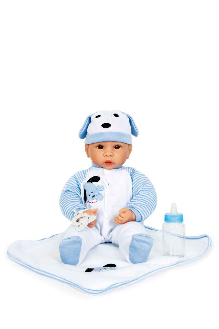 De kleine Benno is een grote vriend van honden. De pop draagt een snoezige slapoor-muts en een blauw-witte kruippakje met een schattig welpje motief. Tutje, knuffeldeken en flesje zijn eveneens blauw-wit.