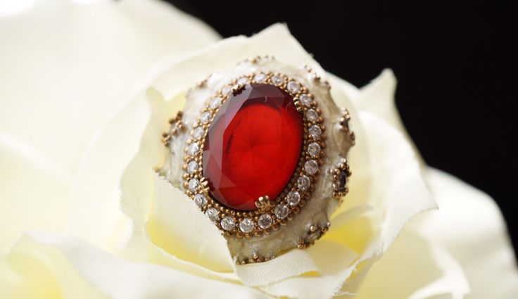 A personal favorite from my Etsy shop https://www.etsy.com/listing/488697287/ruby-enamel-ringsterling-silverantique