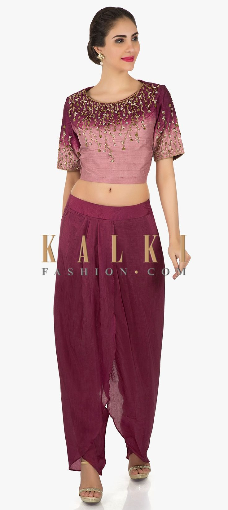 Buy Online from the link below. We ship worldwide (Free Shipping over US$100)  Click Anywhere to Tag Shaded crop top in sequin embroidery matched with dhoti pants only on Kalki Shaded maroon crop top blouse featuring in silk with half sleeve. Its embellished in zardosi embroidery along with sequin. Matched with dhoti pants in maroon cotton.