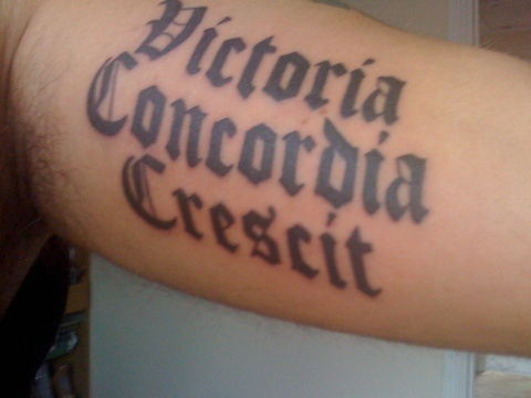 "Arsenal FC motto: ""Victoria, Concordia, Crescit."" In english this means victory comes through harmony."