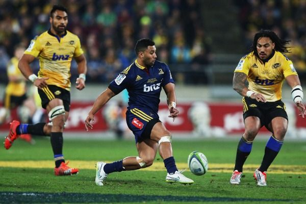 Lima Sopoaga of the Highlanders kicks the ball through to launch an attack.