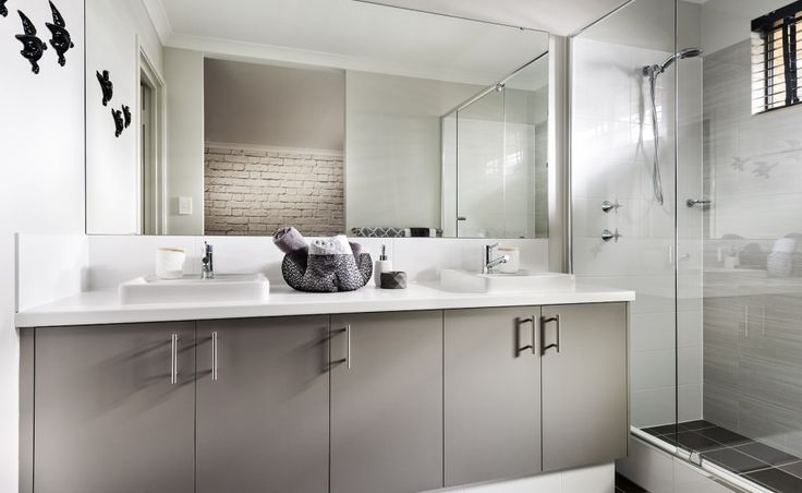 Large ensuite with twin vanity basins, double sized shower and seperate WC