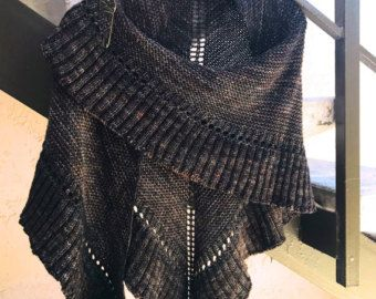 Wrap up in this lovely, hand knit, triangle shawl and look just like Claire on Outlander! It is hand knit just for you in 4 different color options of a lovely tweed Highlands Wool. The shawl is a large, warm, 100% highlands wool, hand knit, triangle shawl, approx 58 from tip to tip, and 28 from center back to bottom tip. Claire wears hers to keep warm while out on the road with the MacKenizes on their quarterly rent collections in Outlander. For you, its perfect with everything from blue…