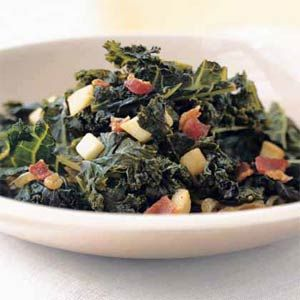 This recipe calls for what might appear to be a lot of kale, but it wilts to a manageable amount in the pan. The dish is a suitable side for roast chicken or pork. Also, consider using kale as a stand-in for spinach in other dishes. This low-calorie side dish has about 15 percent of the minimum daily recommended amount of fiber.