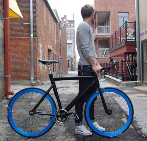 Blue wheeled, bull horned black bike