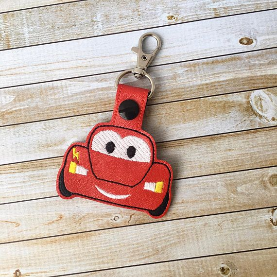 Featured is a Lightning McQueen inspired keychain. It is stitched out on vinyl and ready to ROLL! Fun uses… - Makes for a great gift for Disney Cars fans - Backpack Tags - Clip it on your purse - Attach to a lunch box - Fun Party Favors - Birthday Gifts - Stocking Stuffers - Luggage Tag - Classmates Gifts - Not just for keys. Attach it to your children's items to help them distinguish their stuff  For orders, larger than 5 keychains please send me a direct message for a special order. I…