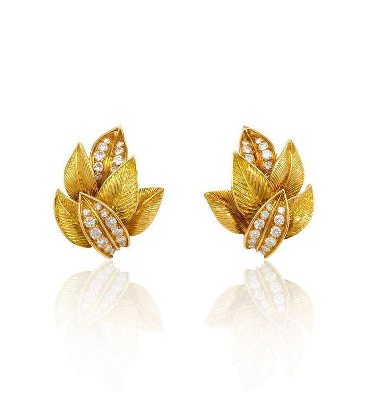 A pair of gold and diamond earrings in the form of textured overlapping leaves, in 18K gold. Van Cleef & Arpels, France. #B3885. Atw 1.50cts...