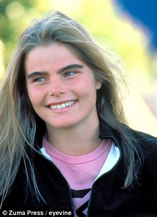 Her eyebrows are similar to mens eyebrows because she has straighter and bushier eyebrows than what you'd see normally. She looks like the 90's.