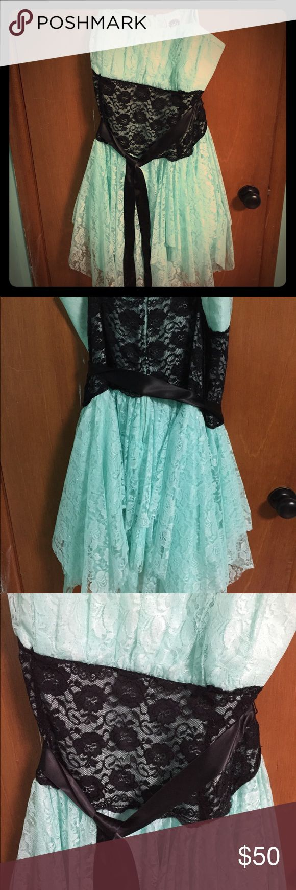 Mint lace formal dress Mint lace formal/prom dress . Has black lace in the middle and a black ribbon tie around the waist. Also has adjustable straps . Debs Dresses Prom