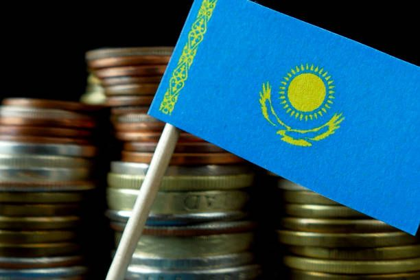 kazakhstan flag waving with stack of money coins macro
