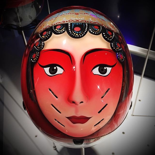 Helmet of Chinese Olympic team sprint cycling champions at Rio 2016 depicting characters from Beijing Opera: women warriors of bravery. Olympic Museum Lausanne. .#lausanne #olympics2016 #vaud #switzerland #cycling #olympiccycling #sports #museeolympique