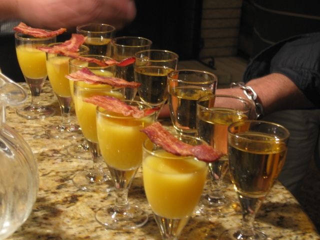 Breakfast Shot Ingredients:  2/3 of a shot of Jameson's Irish Whiskey ,1/3 of a shot of Butterscotch liqueur, Orange juice & Bacon! Bacon! Bacon!  Preparation:  1.	Mix the Jameson's and Butterscotch  2.	Position the OJ as a chaser  3.	Drink the shot, then the OJ quickly  4.	Eat the bacon.  5.	Order again!