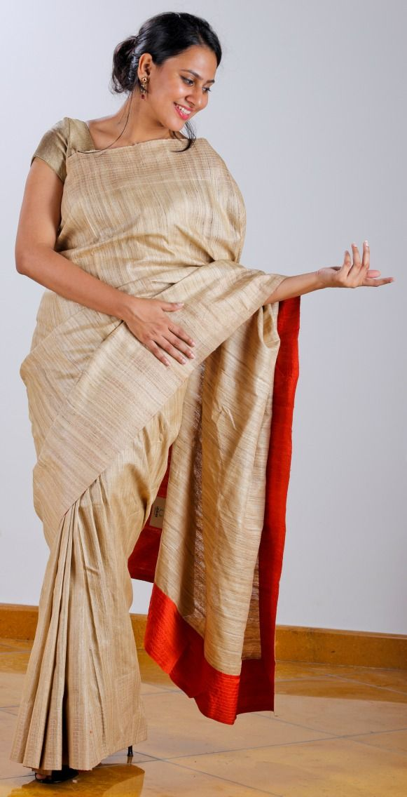Tussar Silk saree with fiery orange silk facing teamed with a geometric [ window grill ] design screen printed Tussar Silk blouse.  SHOP AT www.ubikaa.com