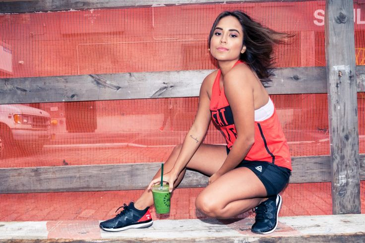 How Taste the Style Founder Cyndi Ramirez-Fulton Spends Her Day:Her latest is Chillhouse, which, you guessed it, is all about escaping the New York hustle, and she's been knee-deep in its construction all while manning her editorial hub, Taste The Style, and managing to make time for a workout. ----- Reebok & Les Mills graphic orange tank top, shorts and sneakers. | Coveteur.com