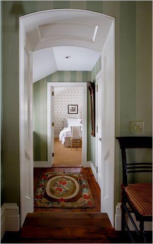 green-striped hallway with white trim