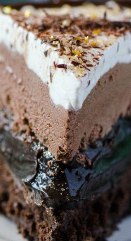 Irish Cream Coffee Mud Pie ~ Coffee turned into pie? Chocolate cookie crust, a flourless chocolate whiskey cake, a layer of chocolate espresso pudding, an Irish cream chocolate mousse, topped off with a sweet whipped cream – it's a chocoholic's dream!