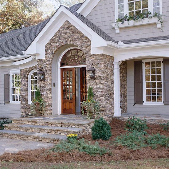 Connect the entry with the rest of your home's exterior by repeating elements that create a cohesive look. A prominent design element, such as the arch in the window above the double doors, reappears in the windows to the left of the entry.