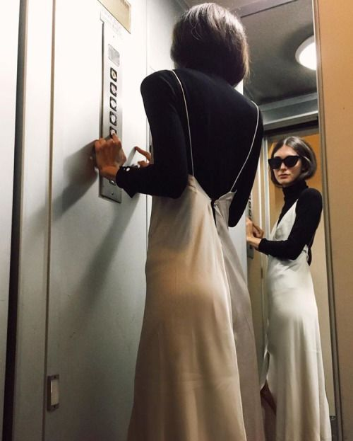 Slip dresses are another current trend. My idea of cool is when you can take a trend and make it your own which this girl has done with a simple black turtleneck under the dress. It's different and unique.