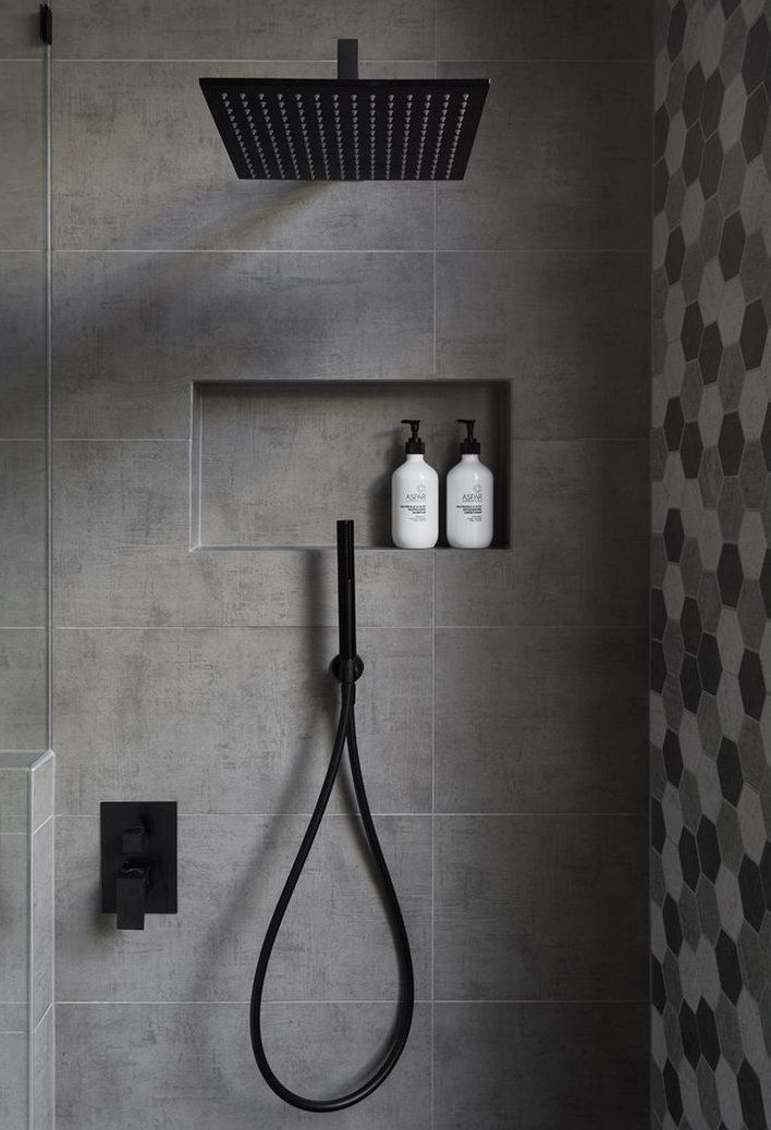 In This Modern Bathroom The Shower Has A Matte Black Rainfall Shower Head And A Hand Held Shower Head A Bathroomideas Modern Bathroom Bathroom Shower Modern Shower