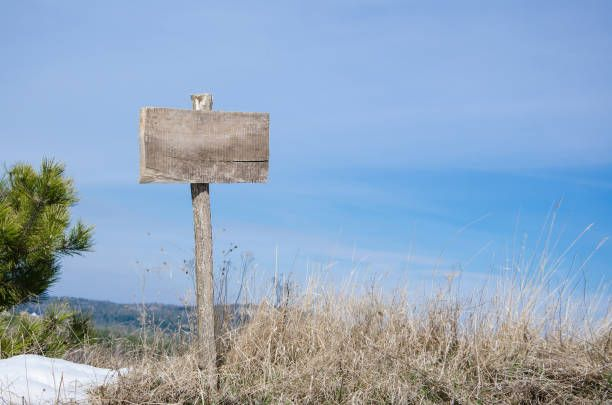 empty wooden sign on the mountain land for sale concept