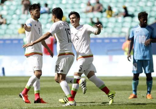 Mexico's Erick Gutierrez, 2nd left, celebrates his goal with teammates Mexico's Oribe Peralta, left, and Mexico's Michael Perez during a group C match of the men's Olympic football tournament between Mexico and Fiji at the Fonte Nova Arena in Salvador, Brazil, Sunday, Aug. 7, 2016. (AP Photo/Arisson Marinho)    -  Brazil disappoints again in men's soccer, draws Iraq 0-0  -  August 7, 2016