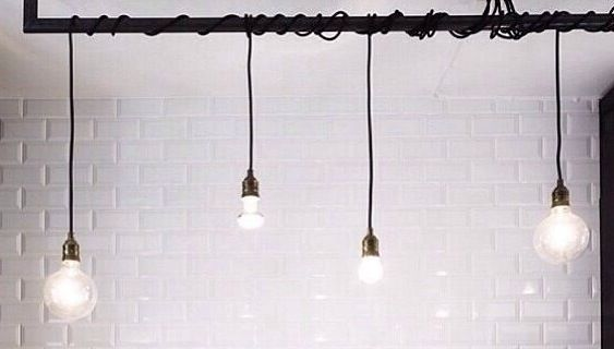 Exposed Edison Lightbulbs. A DIY piece that is so simple yet so effective in creating that raw industrial feel