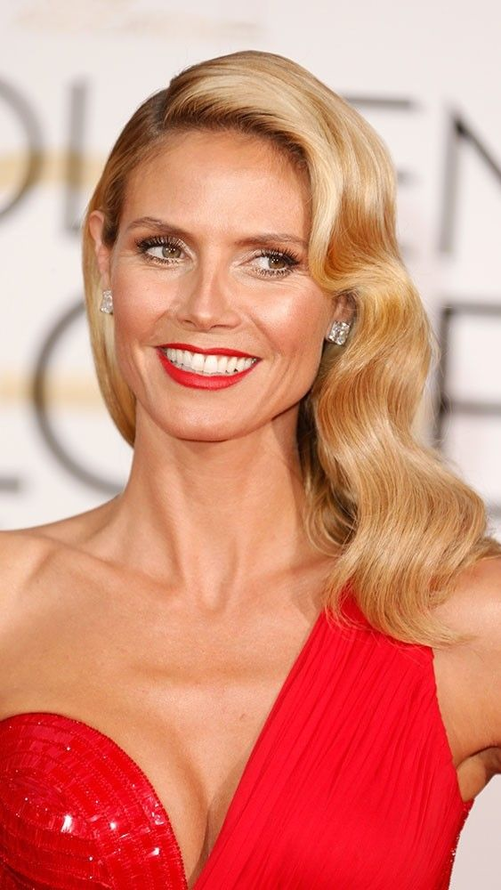 Red on red: Heidi Klum matches her lipstick to her dress. See more photographs from Golden Globes 2015 at www.redonline.co.uk.