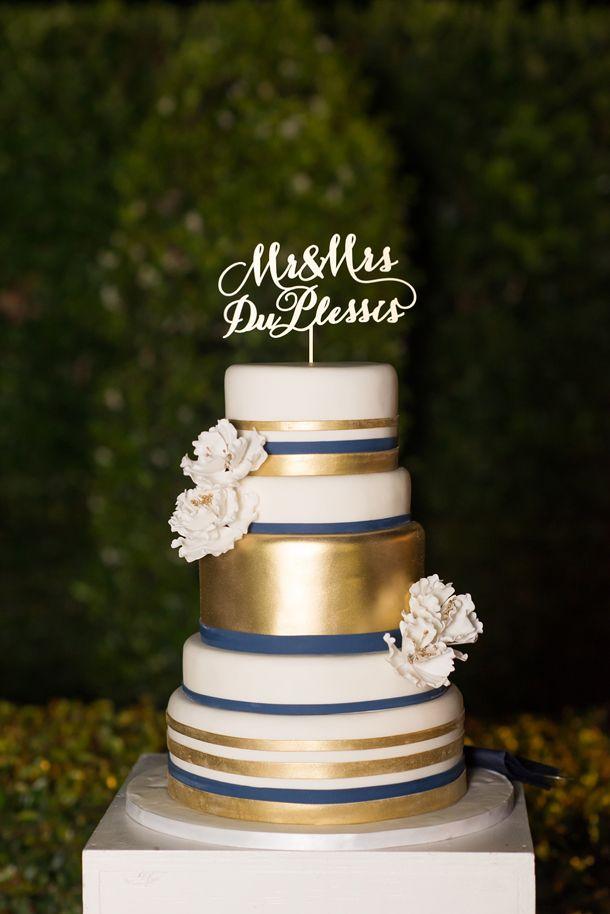 Navy & gold cake   SouthBound Bride   http://www.southboundbride.com/glamorous-navy-pink-gold-wedding-frances-kobus   Credit: Marsel Roothman