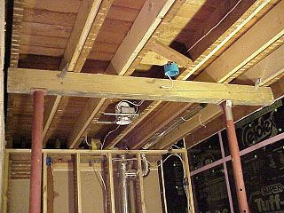Beam And Lally Columns Used Lift Sloping Floor After Joist Sisters Have Been Set Place