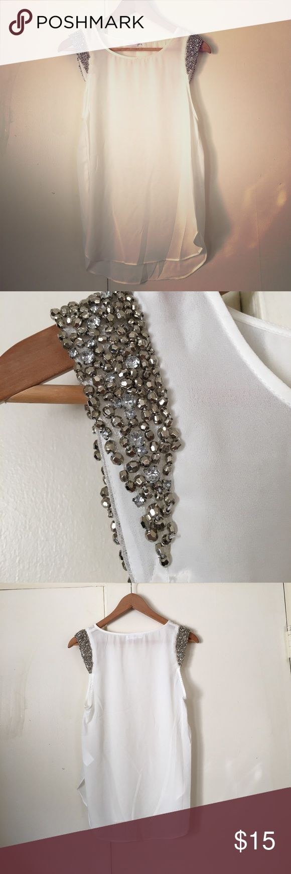Socialite Embellished Sleeve White Blouse - Small So cute!! Semi-sheer white Socialite top in size small. No stretch in the material. Sleeves are heavily embellished and so sparkly. Curved hem at bottom (front and back). This top can be dressed up or down, but it will definitely be the star of the outfit! Pair it with black skinny jeans and booties or shorts with gladiator sandals! Socialite Tops Blouses