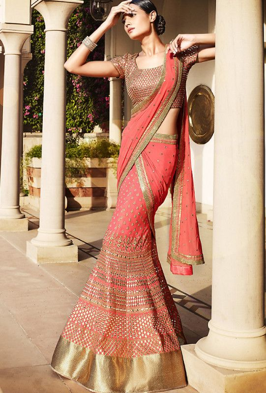Beautiful intricate Pitchish Pink Designer Bridal Lehenga Saree. A perfect example of class, elegance, and sophistication.