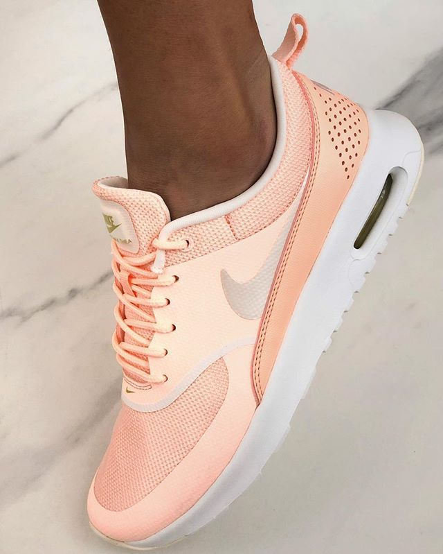 best service 3a034 22db6 Seriously stylish new Nike Air Max Thea shoes in a tinted crimson pink  colour. Worn by tanned woman on marble background. Colour shown  Crimson  Tint Summit ...