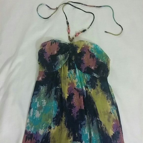 Romeo and Juliet Multi color dress ***Weekend Sale***  Absolutely stunning, multi-colored Romeo & Juliet dress. Beaded accents that ties around. Lined with a royal purple lining. Size Large and made of polyester. Never worn, only tried on.     **Final markdown /Price is firm** Romeo & Juliet Couture Dresses