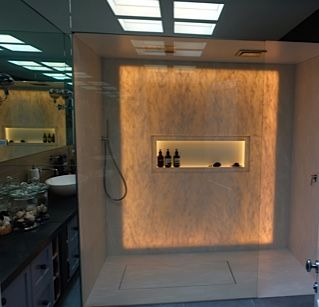 Back-lit shower walls and shower floor. With Corian®