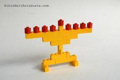 Ok, ok, I knew posting about a LEGO menorah that holds real Hanukkah candles might cause trouble. It did. I now present a few ultra-safe models that use LEGO bits as flames. Thus, nobody gets hu...