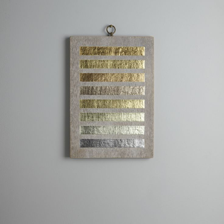Gold Spectrum. 27.5 x 19 cm. Stripes of different colours of gold and palladium leaf on a raw wood background.