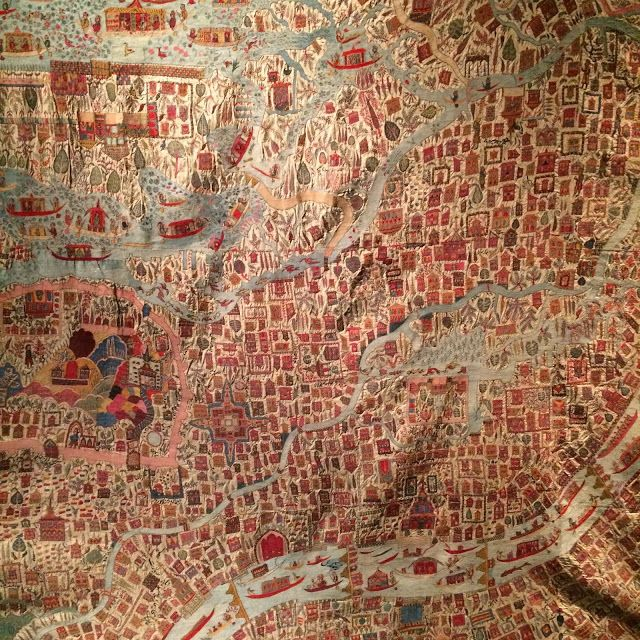 This embroidery shows a stylised map of Srinagar, the capital of Kashmir. The ground fabric is pashmina, the fine goat-hair from which Kashmir shawls are woven, and the minutely detailed plan of the city, including houses, streets and mosques, as well as the blue expanse of Dal Lake and the river Jhelum, are also embroidered.The tiny inscriptions identifying each building and place of interest are all embroidered in English. It was sent as a gift to Queen Victoria in the late 19th century.