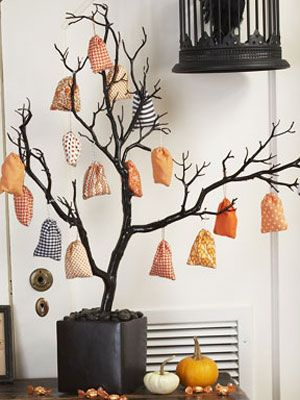 Spray paint a tree branch black, then hang ornaments! Going to do