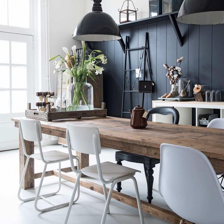 """Isn't this #industrial #blackandwhite #kitchen stylish?! The #refectorytable is definitely a #statementtable to #swoon over. Currently online a newly listed oak """"table de réfectoire"""" click on link in profile to take a look. Stunning @vtwonen #nl #inspo #rusticfarmhouse #modernfarmhouse #modernrustic #farmhousestyle #rustichome #rusticstyle #weathered #popofcolor #vintageinterior #swoon #statement #mismatched"""