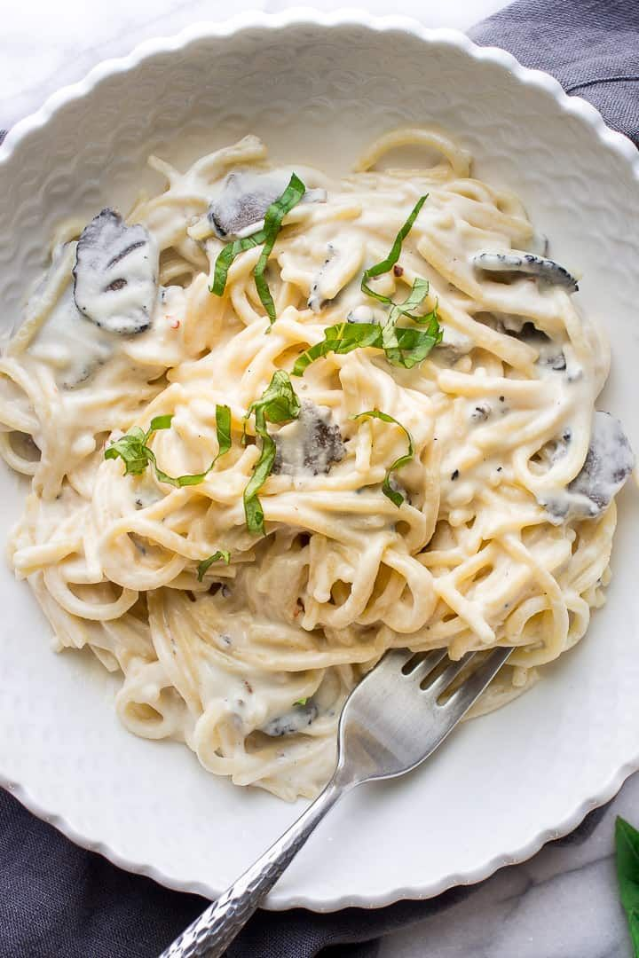 This Healthy Creamy And Delicious Pasta Recipe Is Made With Shaved Black Truffles From A Jar And Cashew Cre Truffle Pasta Truffle Mushroom Yummy Pasta Recipes