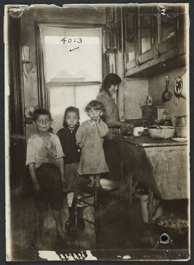 Tenement family in the kitchen, New York, 1915