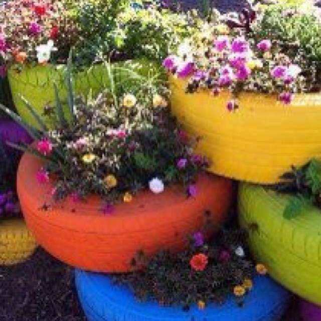 Painting tires fun colors and using them as planters, Brilliant!!