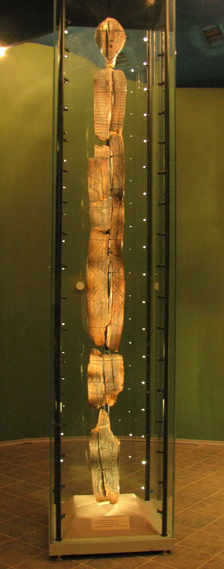"""The Shigir Idol is the most ancient wooden sculpture in the world, made during the Mesolithic period, around 7,500 BCE. It is displayed in the """"Historic Exhibition"""" Museum in Yekaterinburg, Russia. The radiocarbon dating carried out confirmed by the Institute of Geology of the Academy of Science of Russia in Moscow, gives an age of 9,500 years. It is the most ancient known wooden sculpture in the world."""