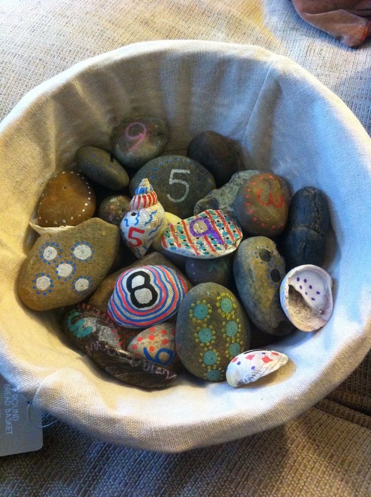 Counting stones for early years education. Home made with beach pebbles and Giotto pens.