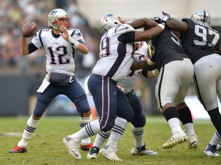 Nov 19, 2017; Mexico City, MEX; New England Patriots quarterback Tom Brady (12) throws a pass against the Oakland Raiders during the second half at Estadio Azteca. Mandatory Credit: Orlando Ramirez-USA TODAY Sports — at Estadio Azteca.