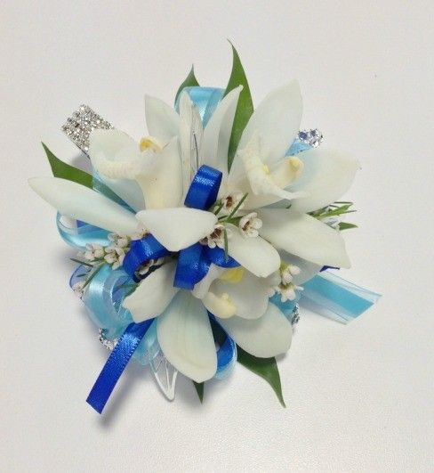 'Spellbinding' by Rose of Sharon Floral Designs.  A vibrant combination of cymbidium orchids with pearl and diamond accents.